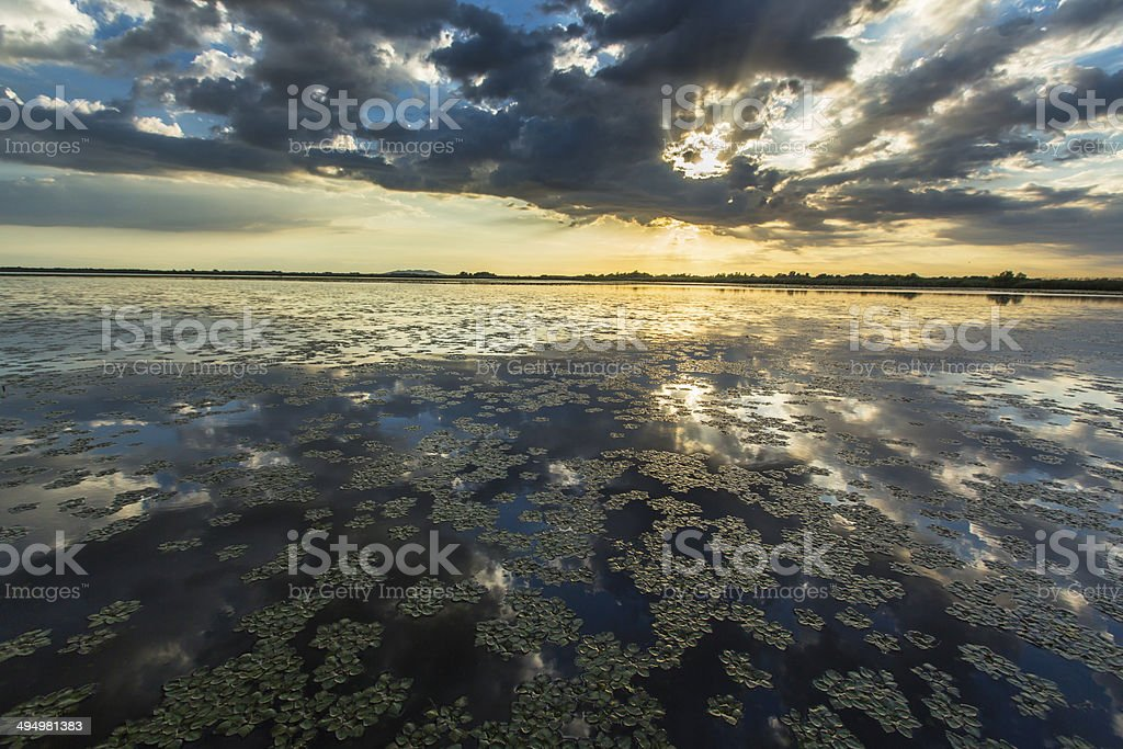 Ominous stormy sky over natural lake stock photo