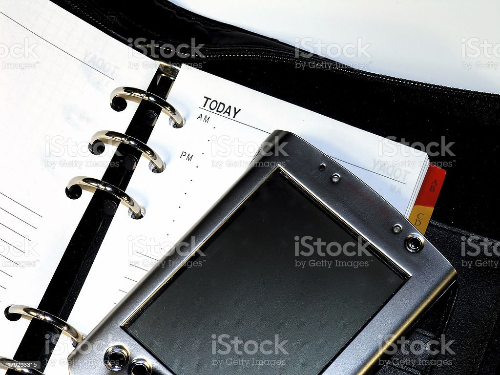 PDA on a Day Planner stock photo