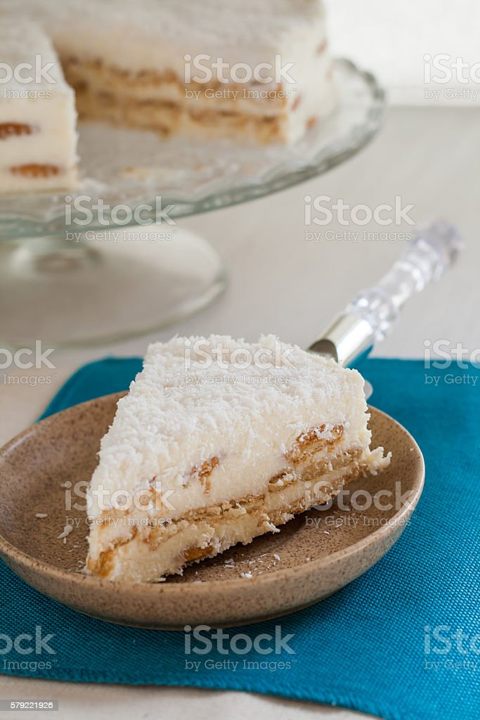 On a piece of coconut cake plate stock photo