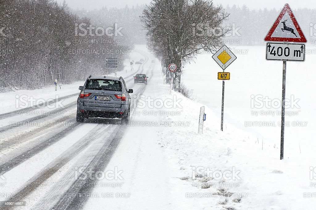 BMW X3 on a road during heavy snow fall royalty-free stock photo