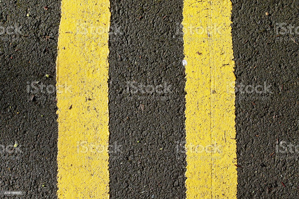 Double yellow lines no parking road surface marking stock photo