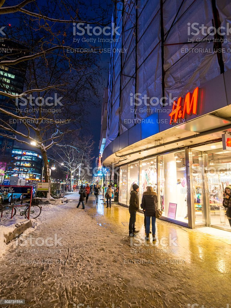 H&M on a snowy night in Berlin, Germany stock photo
