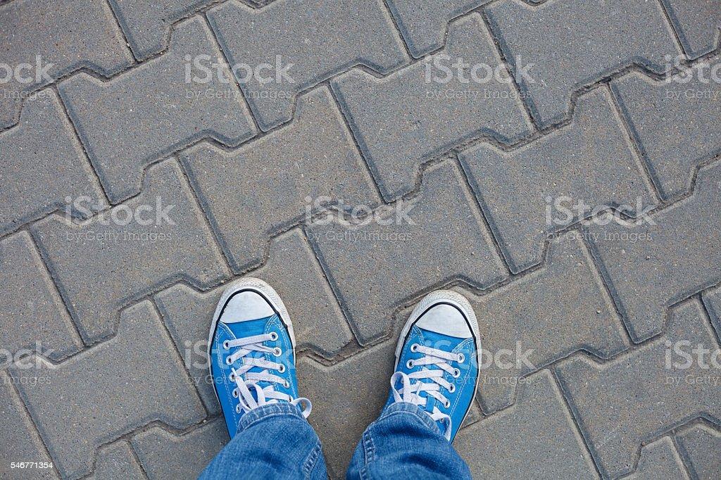 On a walk - wearing sneakers stock photo