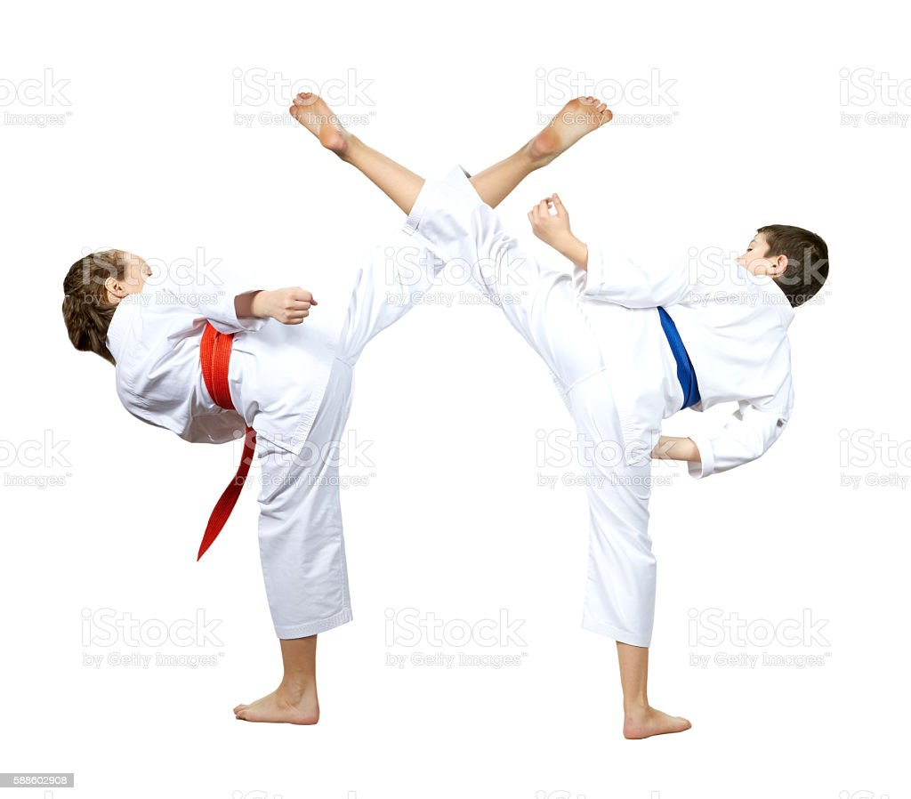 On a white background athletes are beating kick leg stock photo