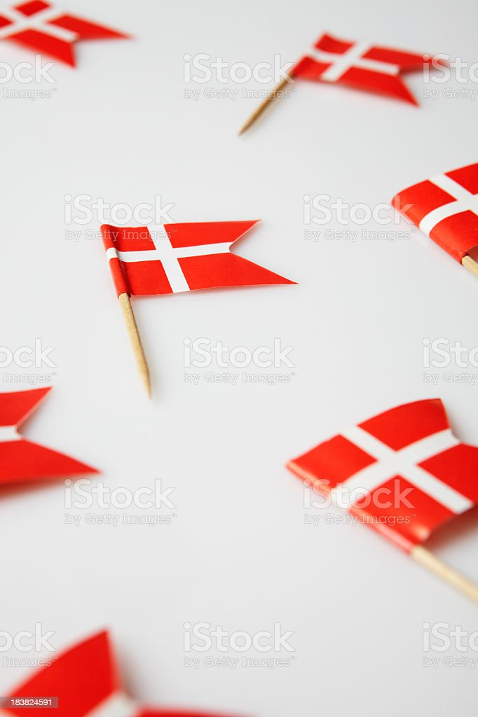 On a white background toothpicks with the Danish flag royalty-free stock photo
