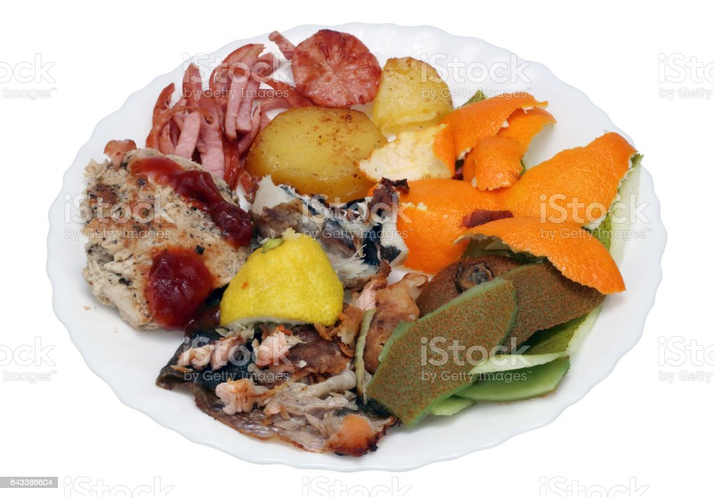 On a white plate - food scraps from a New Year's holiday table. stock photo