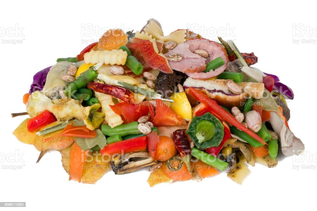 On a white table lies a heap of rotten food waste closeup concept stock photo
