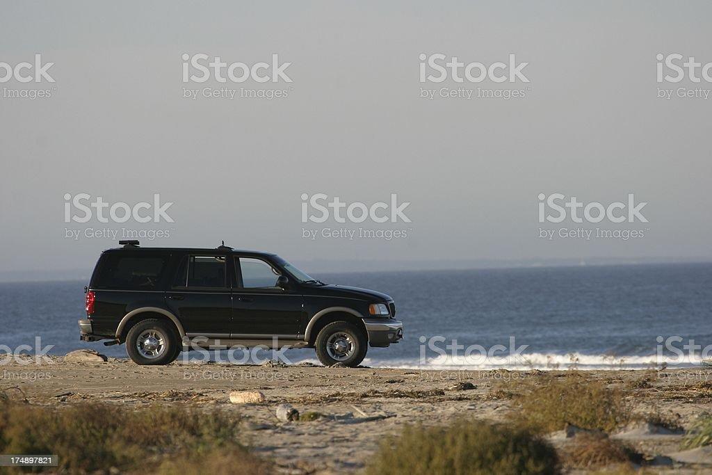 SUV on Beach royalty-free stock photo