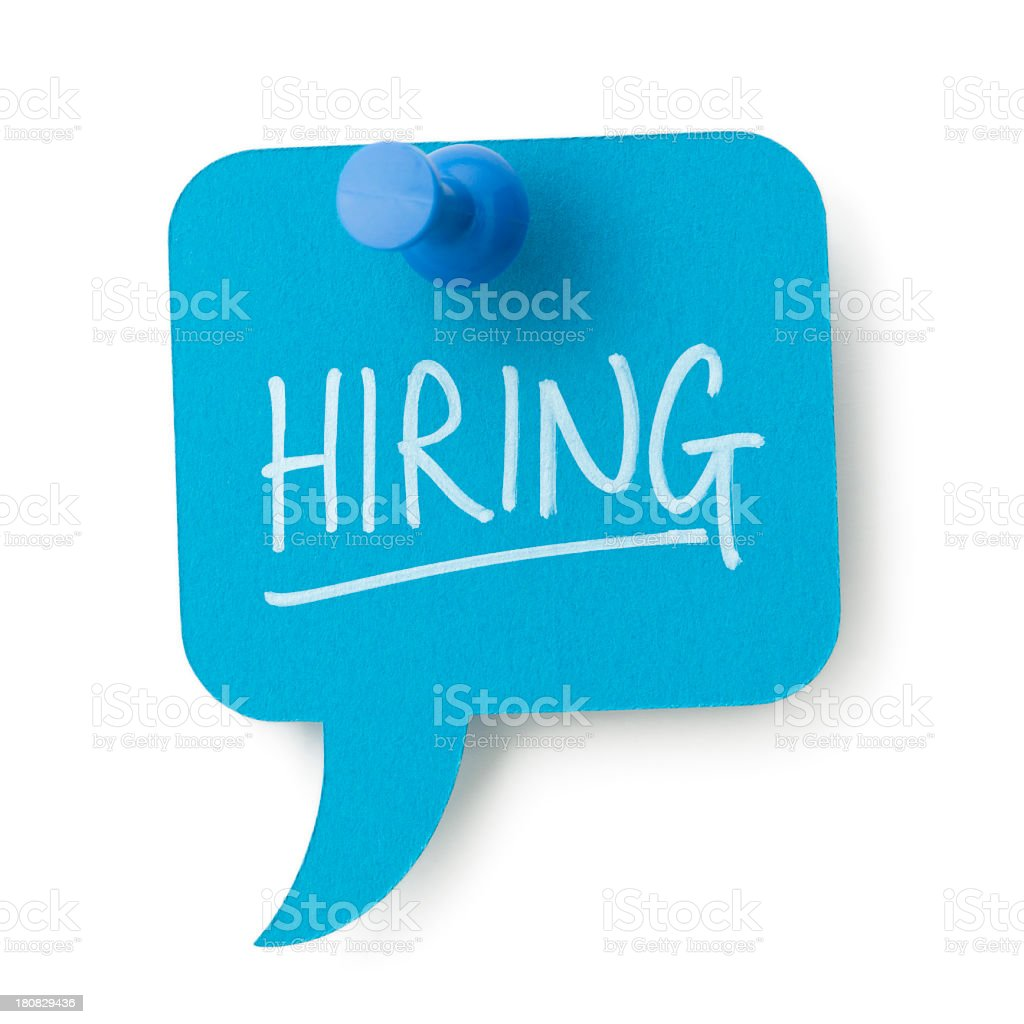 HIRING on blue speech bubble pinned to white surface stock photo
