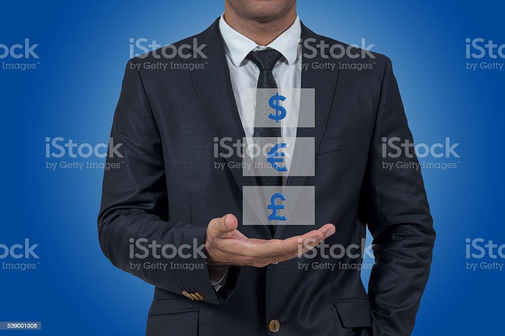 On businessman hand Dollar, Euro, Pound stock photo