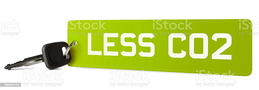 LESS CO2 on car registration plate keyring stock photo