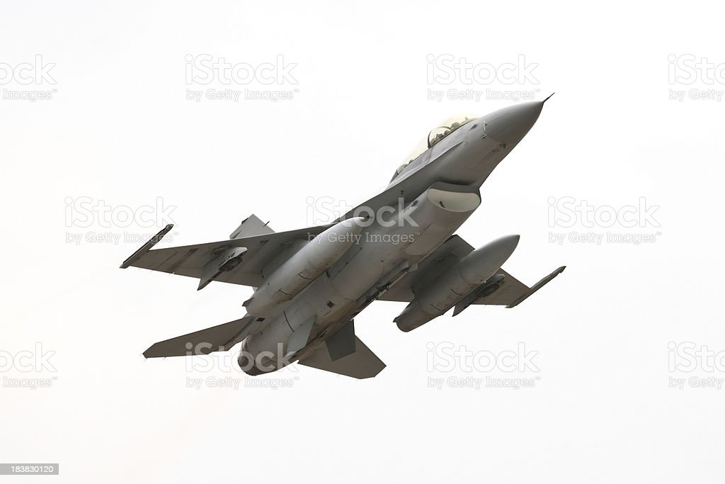 F-16 on cloudy day stock photo