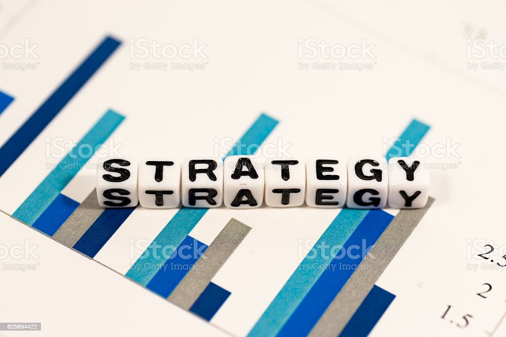 STRATEGY on colorful charts stock photo