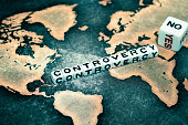 CONTROVERSY on cubes and Yes No dice