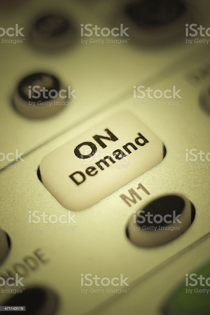 On Demand Button: Close Up Photo of Television Remote Control stock photo