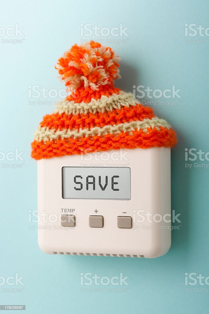 SAVE on digital room thermostat wearing woolly hat royalty-free stock photo