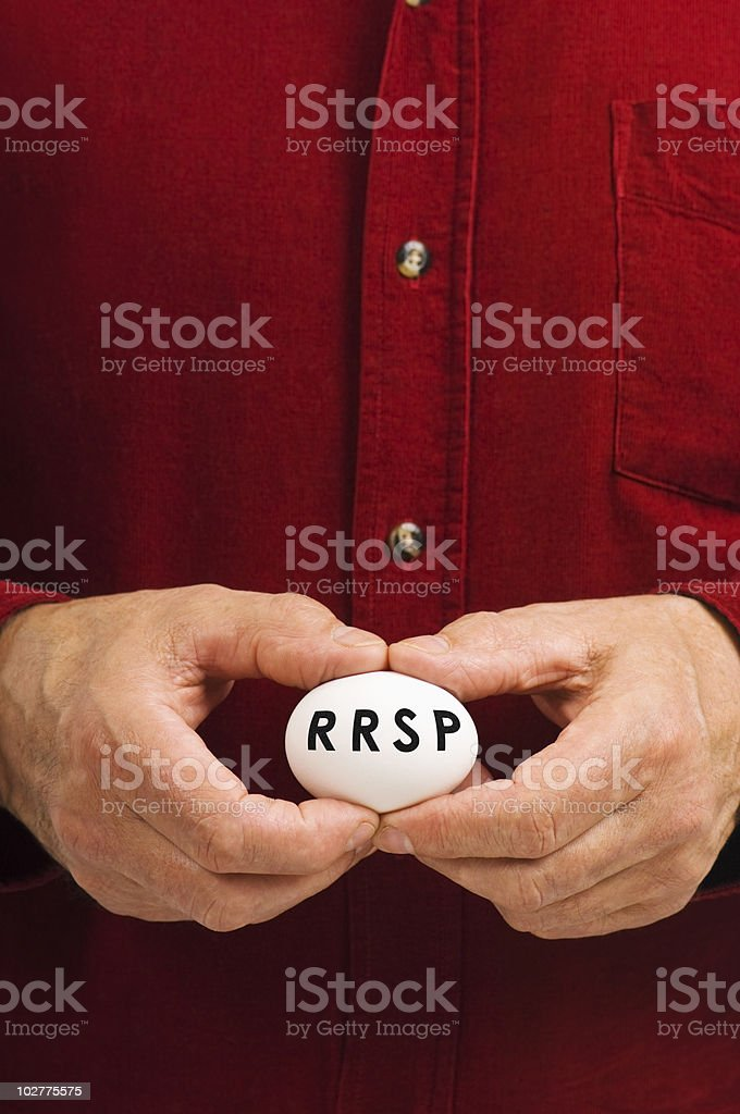 RRSP on egg held by man stock photo