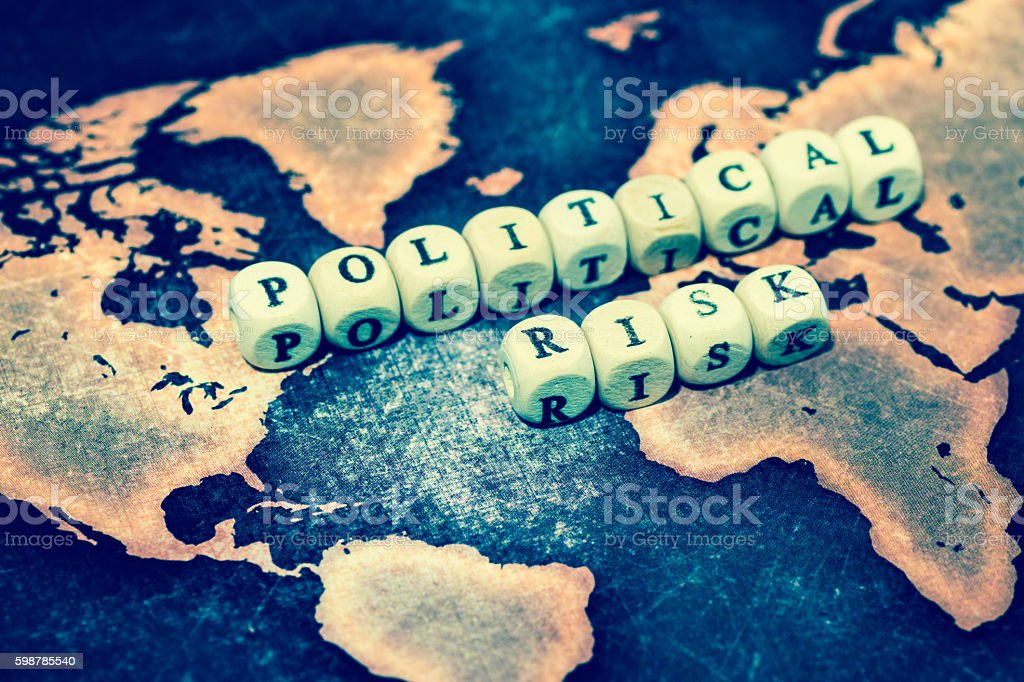 POLITICAL RISK on grunge world map stock photo