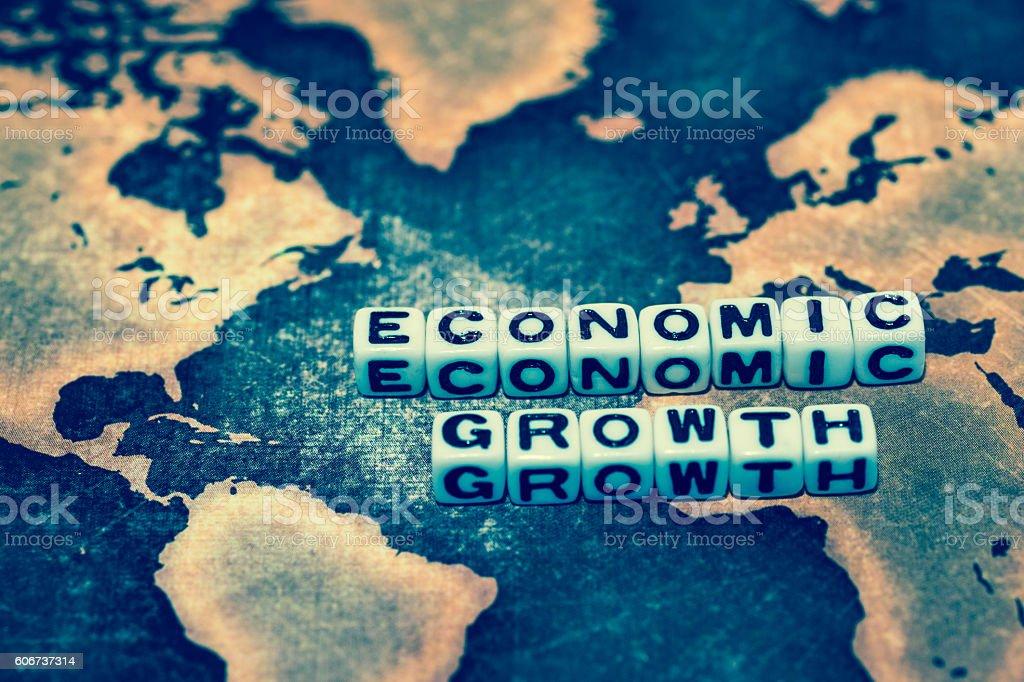 ECONOMIC GROWTH on grunge world map stock photo