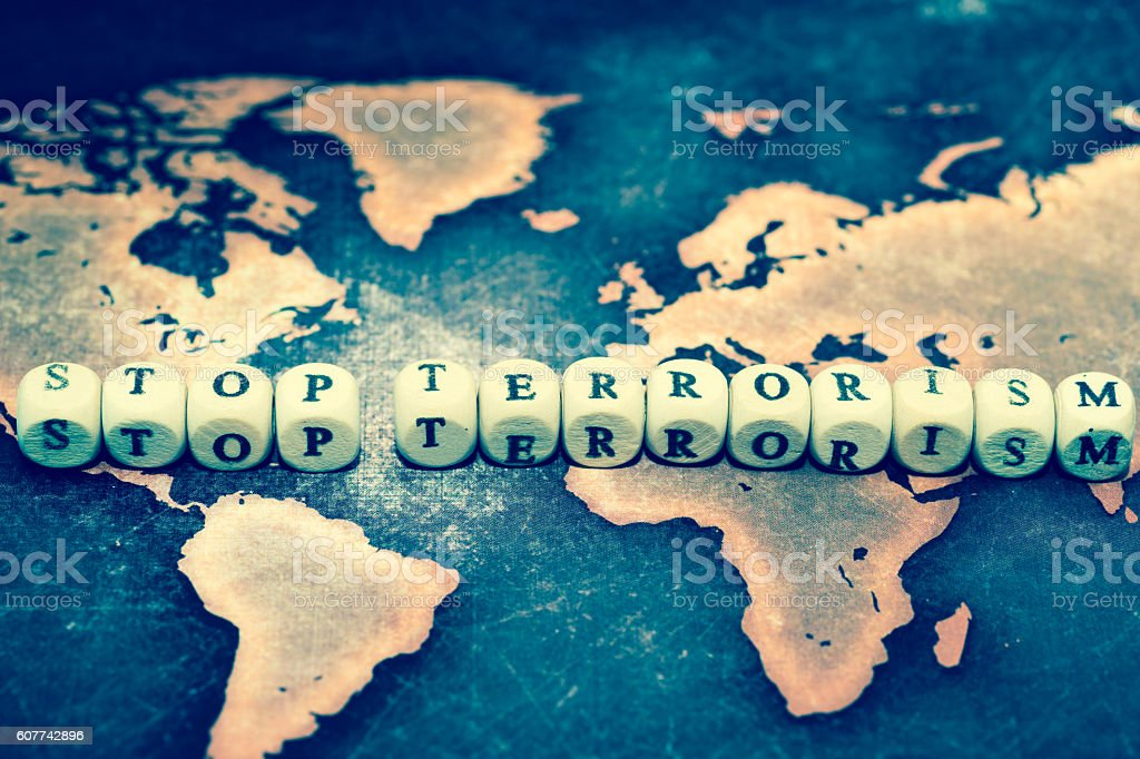 STOP TERRORISM on grunge world map stock photo