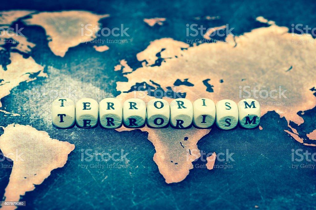 TERRORISM on grunge world map stock photo