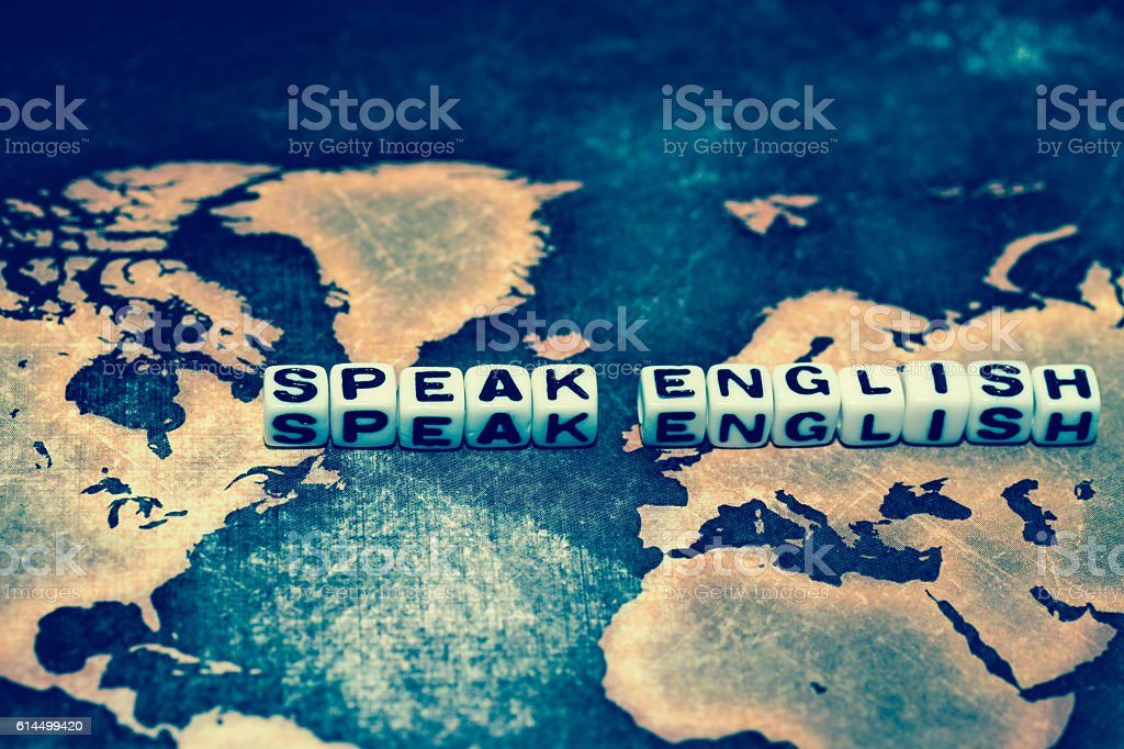 SPEAK ENGLISH on grunge world map stock photo
