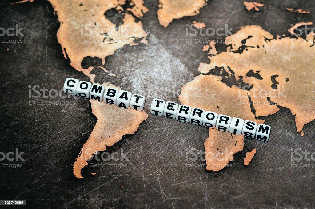 COMBAT TERRORISM on grunge world map stock photo