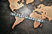 COMBAT TERRORISM on grunge world map