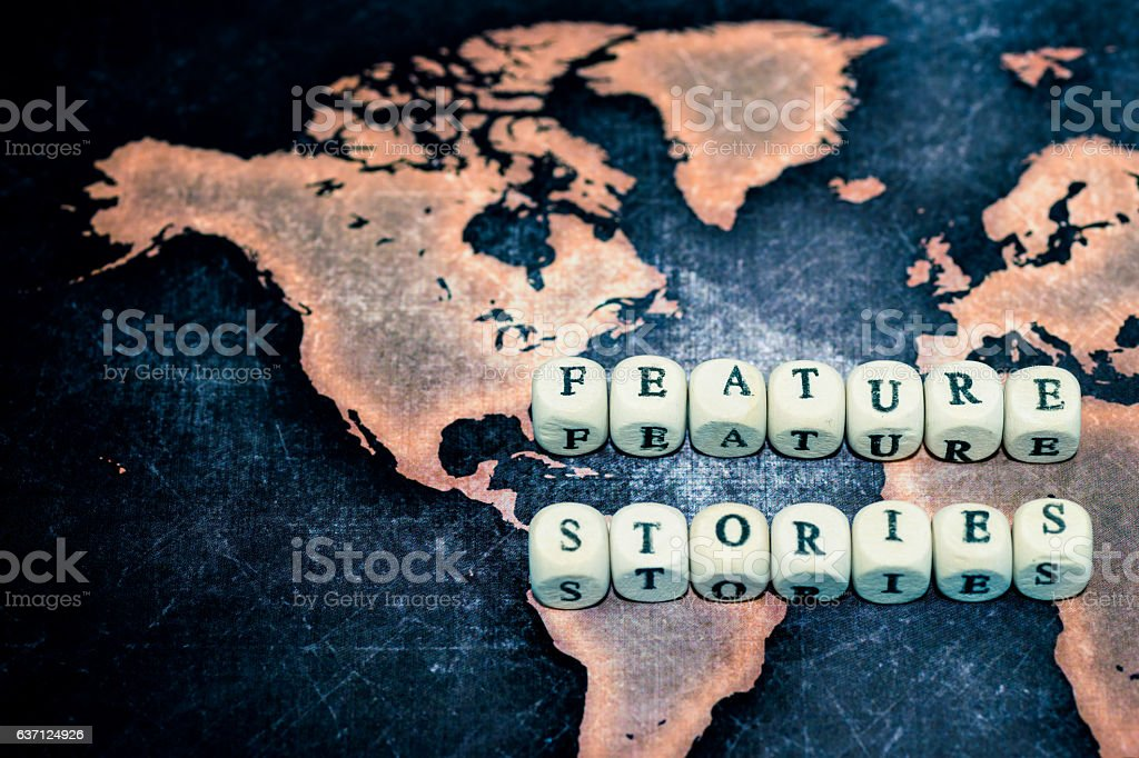FEATURE STORIES on grunge world map stock photo