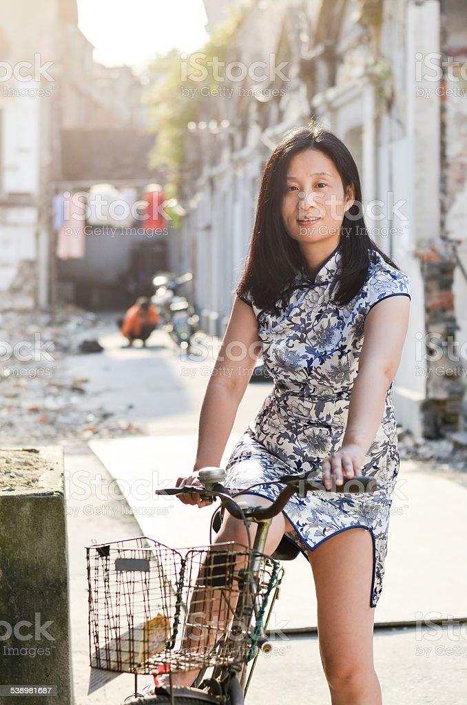 On her bike stock photo