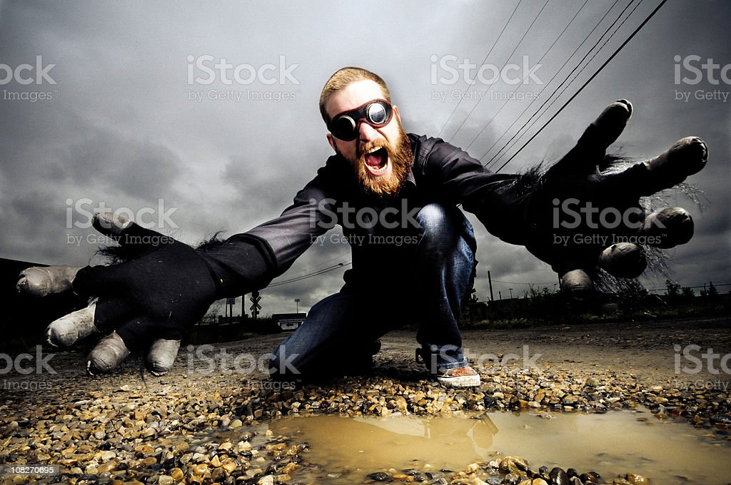 On his knees reaching royalty-free stock photo