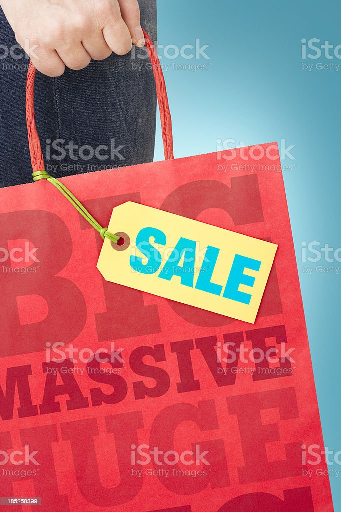 SALE on label attached to shopping bag stock photo