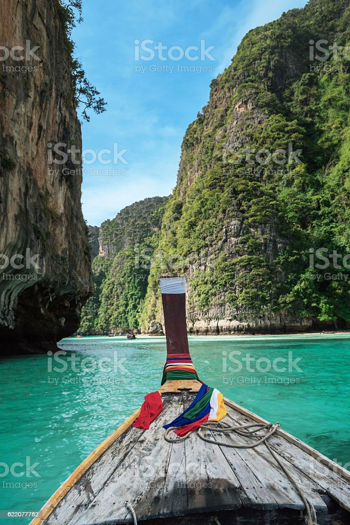 On longtail boat in pile bay on Koh Phi Phi stock photo