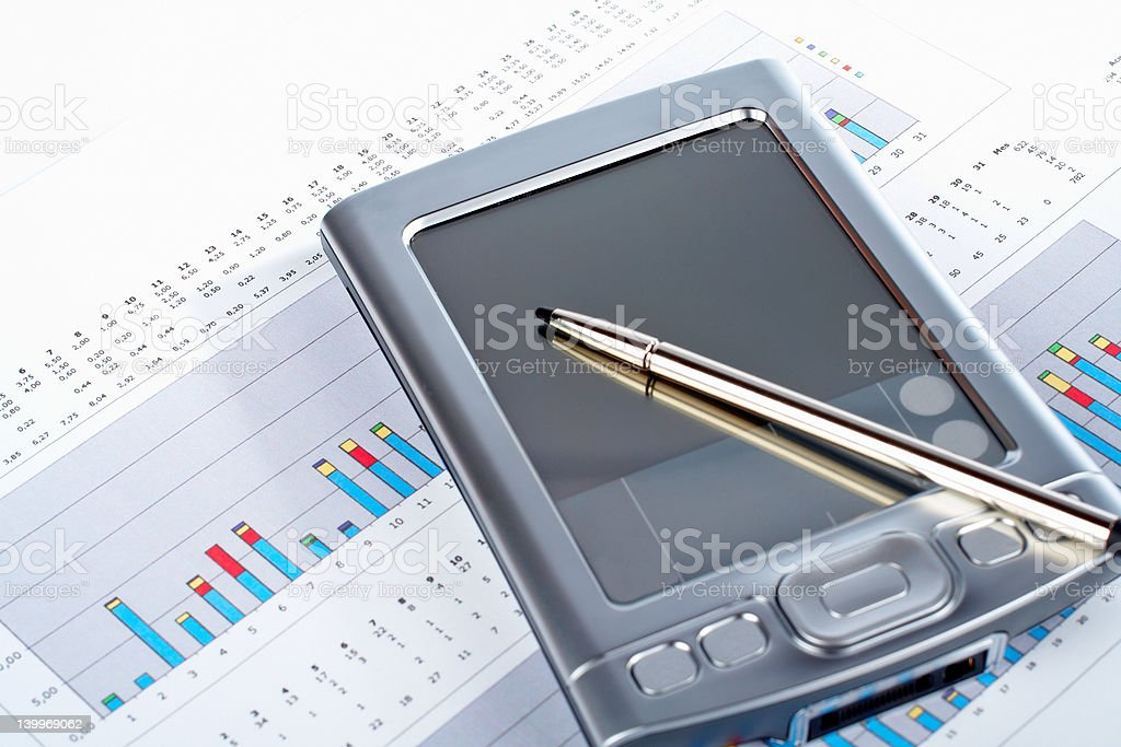 PDA on market financial chart background royalty-free stock photo