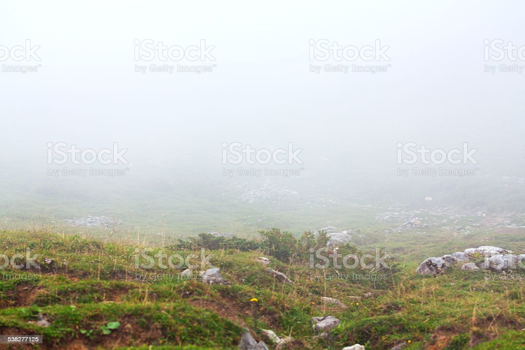 On mountain Hoher Ifen in fog and clouds stock photo