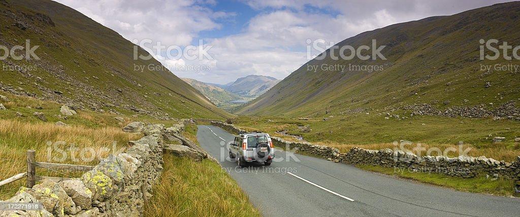 SUV on mountain pass stock photo