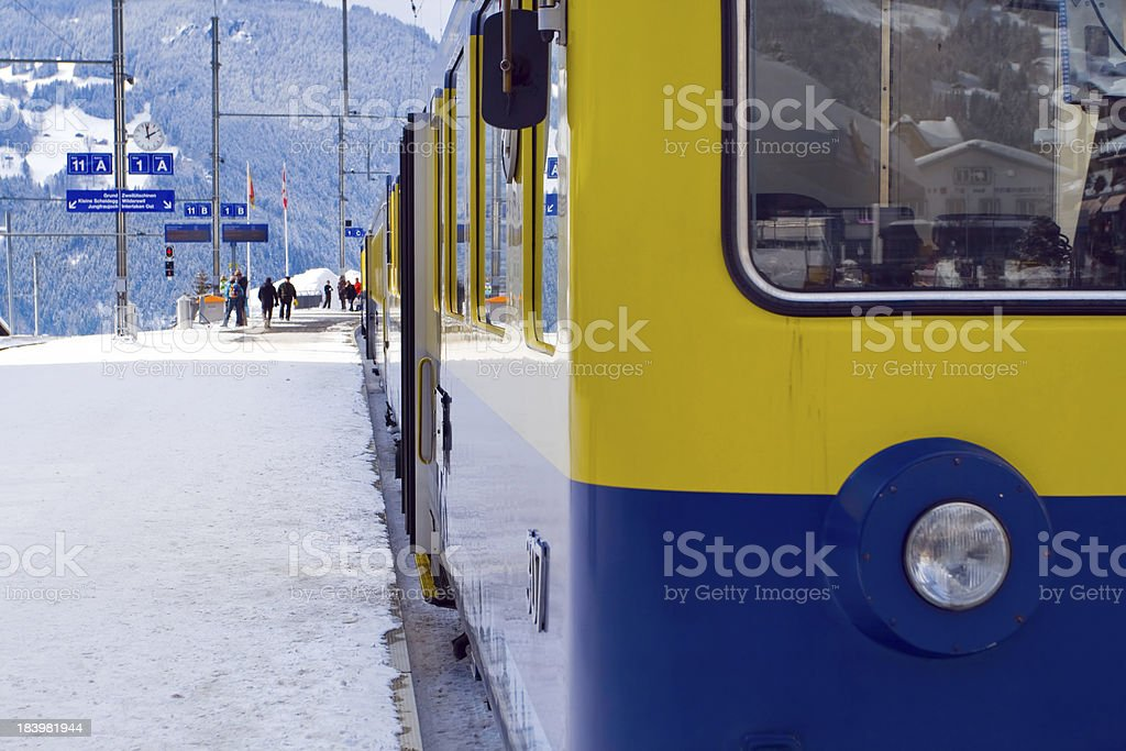 On platform near the train Interlaken-Grindelwald, Swiss stock photo