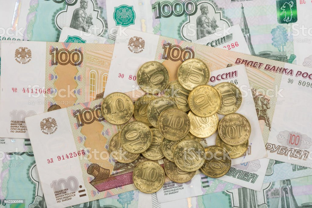 On randomly scattered banknotes Russian rubles is a bunch of ten-coin stock photo