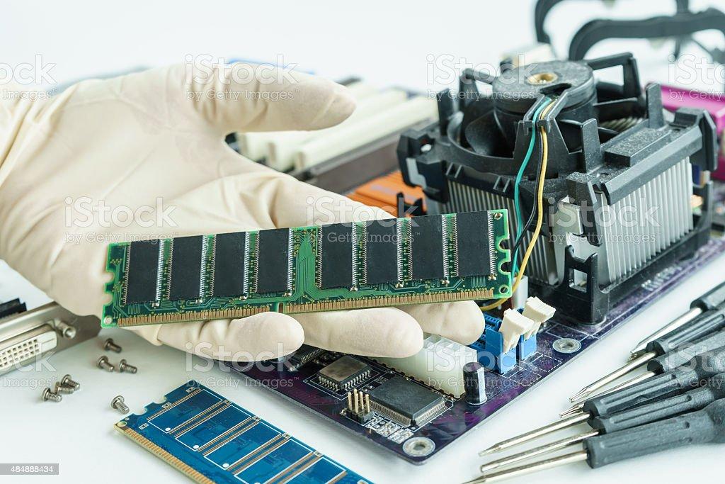 RAM on repairman hand to check and repair stock photo