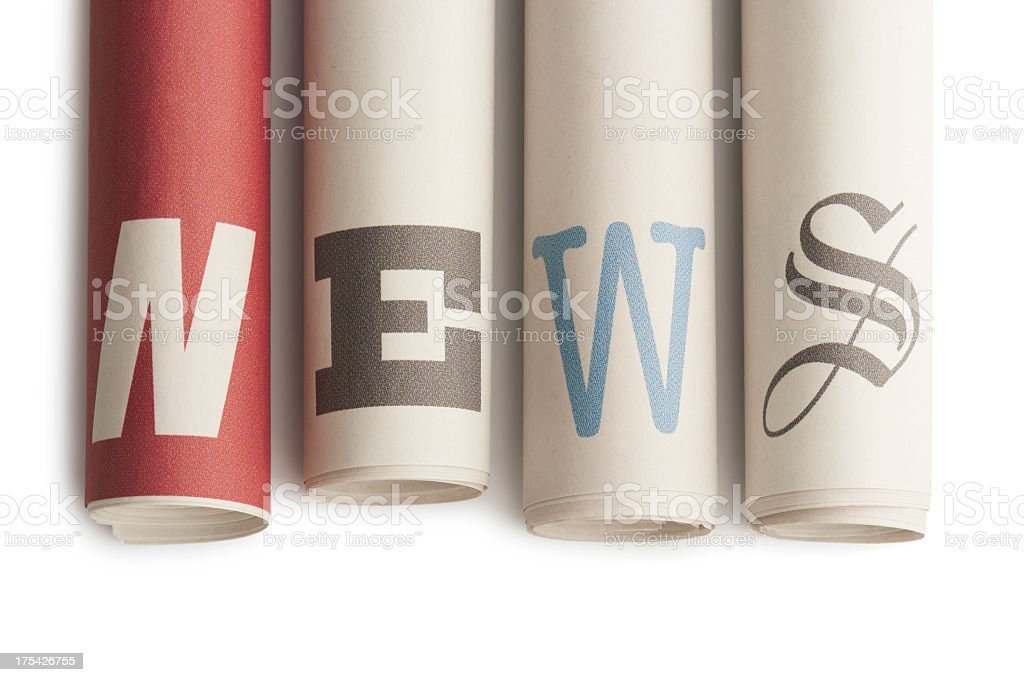 NEWS on rolled up newspapers royalty-free stock photo