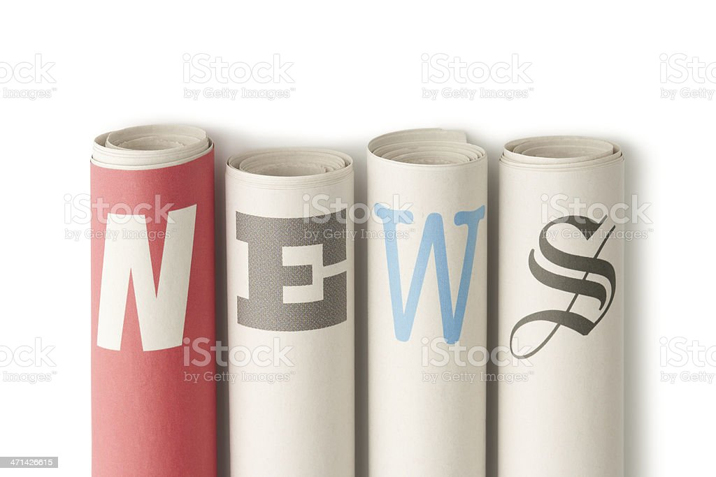 NEWS on rolled up newspapers stock photo
