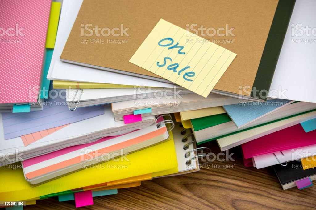On Sale; The Pile of Business Documents on the Desk stock photo