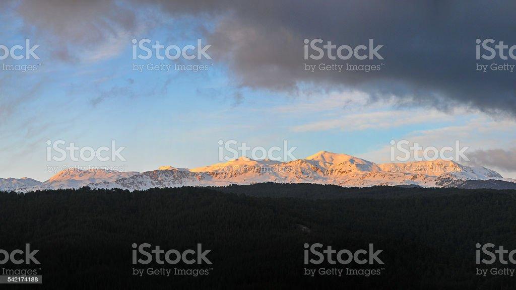 on snowy mountains in clouds. Turkey, Central Taurus Mountains, Aladaglar stock photo