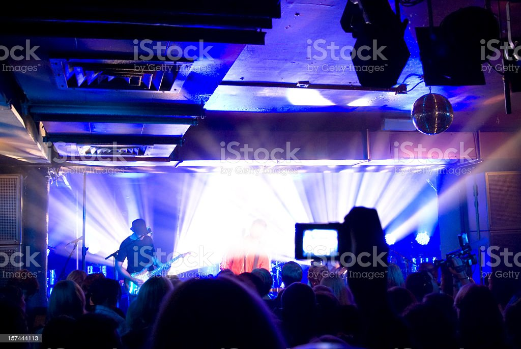 On stage, live concert in club, light show, fans cheering stock photo