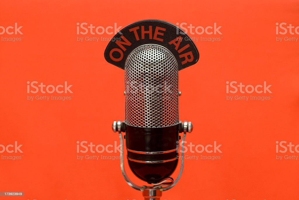on the air microphone red background stock photo