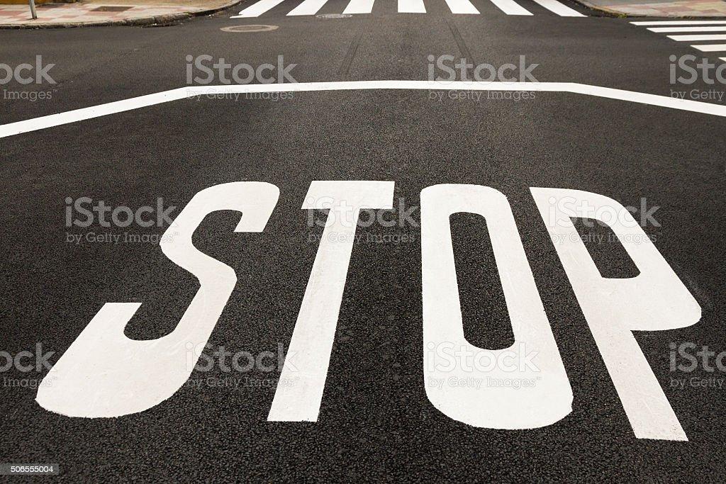 STOP on the Asphalt, recently painted - STOP  en Asfalto stock photo