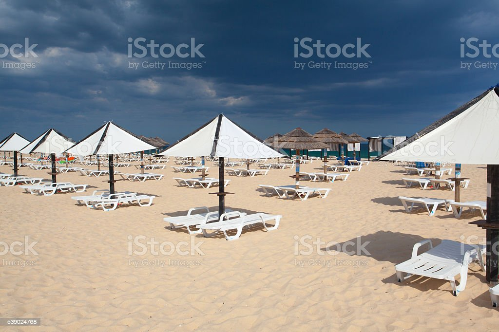 On the beach on Tavira island before storm,Portugal stock photo