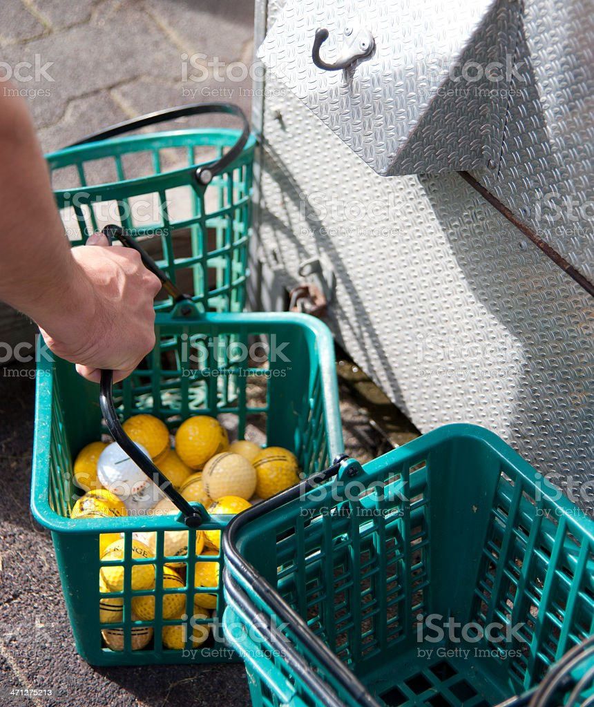 on the driving range baskets with balls royalty-free stock photo
