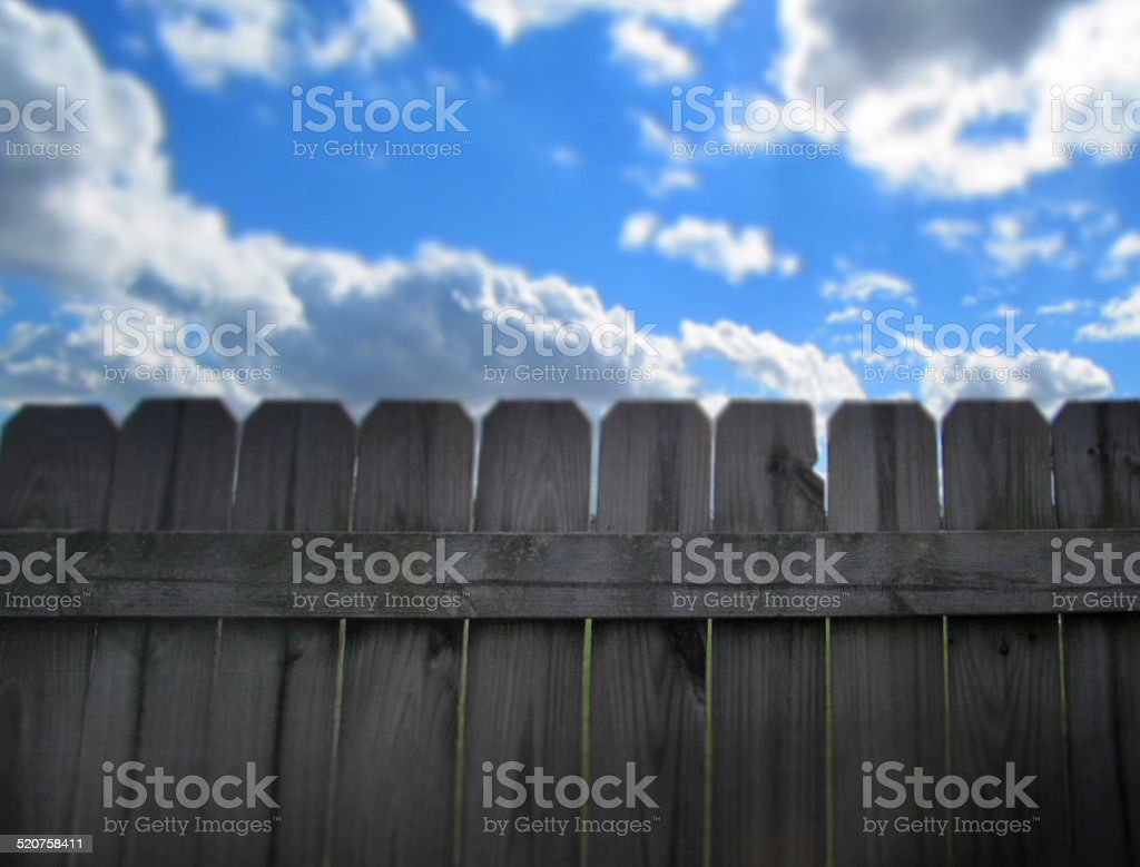 On the fence stock photo