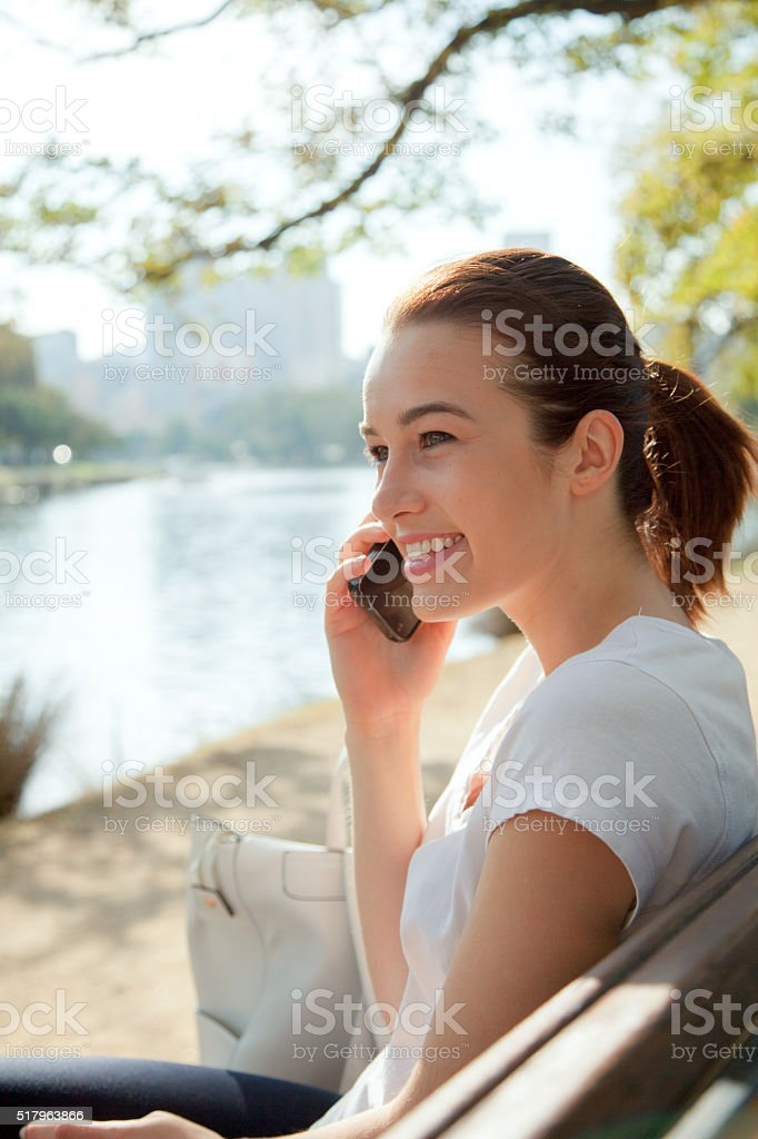 On the Phone on the Banks of the Yarra stock photo
